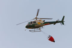 Fire rescue helicopter, with water bucket Stock Photography