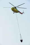 Fire rescue helicopter with water bucket Royalty Free Stock Photos