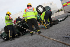 Fire and Rescue staff at car crash training Stock Photo