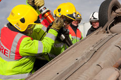 Fire and Rescue staff at car crash training Royalty Free Stock Image