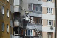 Fire in residential building. Firefighters extinguish a fire in a building in Moscow Royalty Free Stock Photos