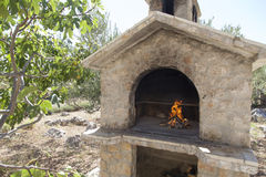 Fire in rich bbq fireplace. Fire in traditional rich bbq fireplace, made from brics Stock Photos