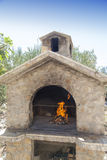 Fire in rich bbq fireplace. Fire in traditional rich bbq fireplace, made from brics Stock Photography