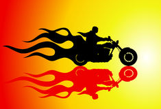 Fire rider. Motorcyclist riding on a fiery background Royalty Free Stock Photography
