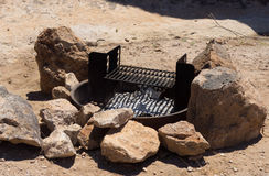 A fire ring at a campsite in the desert Royalty Free Stock Images