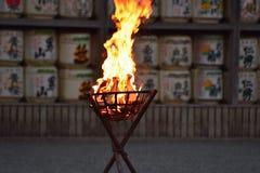 Fire ritual outside Japanese Shrine Stock Image