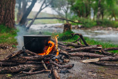 Fire at the river. A fire and making coffee in a clearing near the river Stock Photo