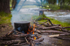 Fire at the river. A fire and making coffee in a clearing near the river Royalty Free Stock Images