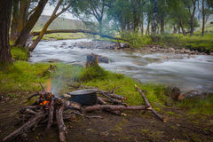 Fire at the river. A fire and making coffee in a clearing near the river Stock Images