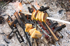 Fire roasted cheese and bread Royalty Free Stock Photos