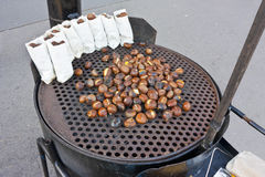 Fire roasting chestnuts Stock Photo