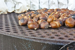 Fire roasting chestnuts Royalty Free Stock Photos