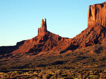 Fire and Rock. Early morning sunlight on rock protrusions in Monument Valley, Utah stock photos