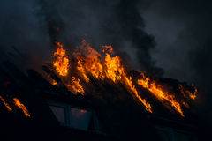 Fire on the roof Royalty Free Stock Photography