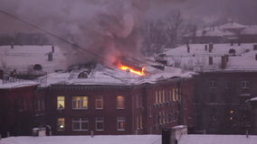 Fire on the roof of a house in Moscow