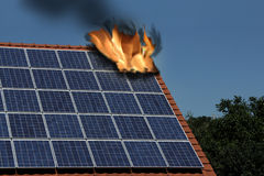 Fire on the roof. With solar moduls Stock Photo