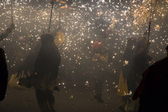 Fire Run, La Merce. Barcelona, Spain- September 20, 2015: Fire Run or Correfoc, La Merce, Groups dress as devils and parade down the streets letting off Stock Photography