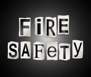 Fire safety concept. 3d Illustration depicting a set of cut out printed letters arranged to form the words fire safety Stock Photography