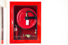Fire safety equipment. In the red box on wall cement Stock Photo