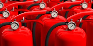Fire extinguishers closeup background. 3d illustration. Fire safety. Group of red fire extinguishers, closeup view. blur background. 3d illustration Royalty Free Stock Image