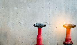 Fire safety pump on cement floor of concrete building. Deluge system of firefighting system. Plumbing fire protection. Red fire. Pump in front of concrete wall royalty free stock photos