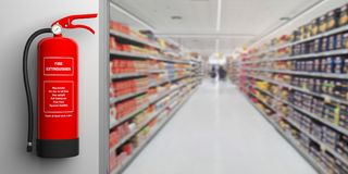 Fire extinguisher on a wall, blur supermarket corridor background. 3d illustration. Fire safety, Red fire extinguisher on wall, blur supermarket corridor Stock Image