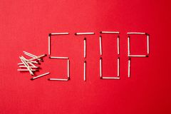 Fire safety, or security and protection concept. Stop sign of matches on a red background. Fire safety or security and protection concept. Stop sign of matches royalty free stock photos