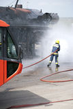 Fire safety training. Firefighter using hose during fire safety training exercise Royalty Free Stock Photography