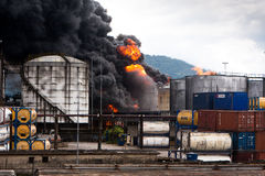 Fire in Santos, Brazil. Fire at refinery next to the Port of Santos in Alemoa neighborhood of Santos, Brazil Royalty Free Stock Images