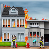Fire scene. House on fire and two firemen working at the scene Stock Photo