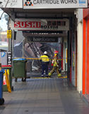 Fire Search and Rescue begin searching the remains of a shop aft Royalty Free Stock Photo