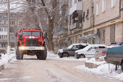 Fire service car rides in the courtyard of apartment buildings Royalty Free Stock Photography