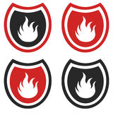 Fire shield. Emblem of fire in shield as symbol of protection or fire service Royalty Free Stock Photo