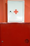 Fire shield and first aid box on the wall Stock Photos
