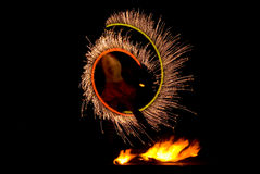 Fire show. Enchantling fire show at night Stock Photo