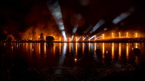 Fire show across the lake with light tubes. Burning fire show with light tubes stock video