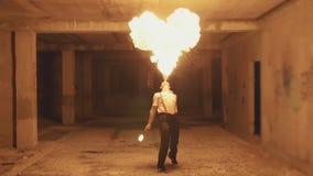 Fire show artist breathe fire in the dark, slow motion