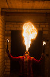 Fire show artist breathe fire in the dark Royalty Free Stock Photography