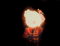 Fire show artist breathe fire in the dark Royalty Free Stock Images