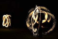 Fire show - artists juggling with burning tools in the dark royalty free stock photography