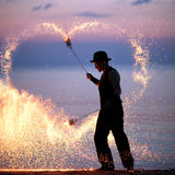 Fire show on the beach at sunset Royalty Free Stock Photography