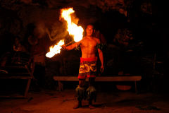Fire show in famous Hina cave, blurred motion, Oholei beach, Ton Royalty Free Stock Photos
