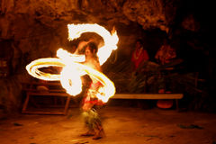 Fire show in famous Hina cave, blurred motion, Oholei beach, Ton Stock Photos