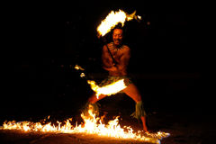 Fire show in famous Hina cave, blurred motion, Oholei beach, Ton Royalty Free Stock Image