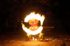 Fire show in famous Hina cave, blurred motion, Oholei beach, Ton Royalty Free Stock Photo
