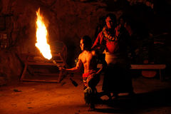 Fire show in famous Hina cave, blurred motion, Oholei beach, Ton Stock Images