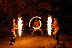 Fire show in famous Hina cave, blurred motion, Oholei beach, Ton Stock Photo