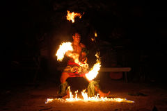Fire show in famous Hina cave, blurred motion, Oholei beach, Ton Royalty Free Stock Photography