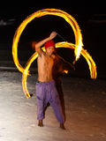 Fire show festival at the beach. PANGLAO, PHILIPPINES - FEBRUARY 20, 2014 :Fire show festival at the beach. Unidentified man performing a dance with fire Royalty Free Stock Photos