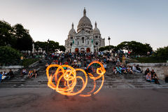 Fire Show in front of Sacre Coeur Cathedral in Paris, France Stock Photography